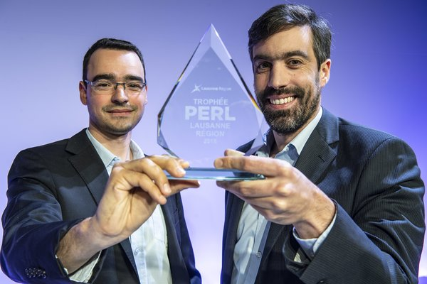 The SamanTree Medical co-founders holding the PERL trophy.